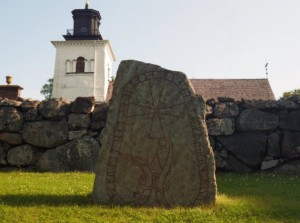 Runestone at Övergran church.
