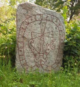 Runestone at Hjälsta church.