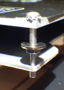 A shakeproof washer and a nut secure the M3 screw.