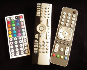 The three main remotes in my living room.